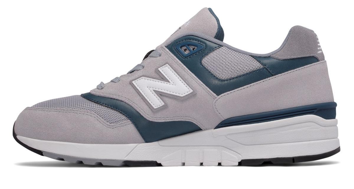 new balance 597 uomo grigio